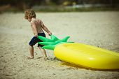Cute Child Dragging Air Mattress At Seashore. Toddler On Vacation, Summer Holidays Going To Swim On  poster