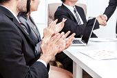 Business People Clapping Hands In The Meeting poster