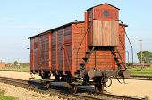 stock photo of auschwitz  - Deportation wagon at Auschwitz Birkenau at Auschwitz Birkenau concentration camp Poland - JPG