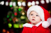 stock photo of baby toddler  - Portrait of a sweet toddler in Santa hat - JPG