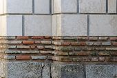 Weathered Brick Wall Made Of Blocks With Various Color And Size, Large White Blocks On Top, Small Re poster