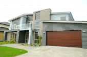 brand new show home with landscaped front yard poster