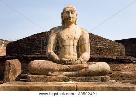 Ancient Buddha Statue With Blue Sky On Background