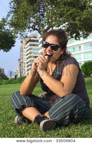 Peruvian Woman Biting on Mobile Phone