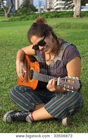 Peruvian Woman Playing Guitar