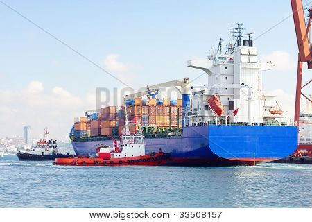Tug boats pulling Container ship