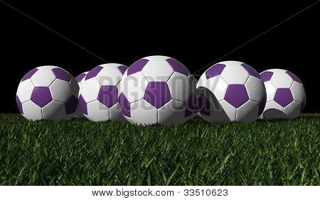 Purple Soccer Balls On A Green Grass
