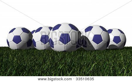 Blue Soccer Balls On A Green Grass