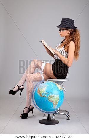 Sexy Teacher Holding A Book On Grey