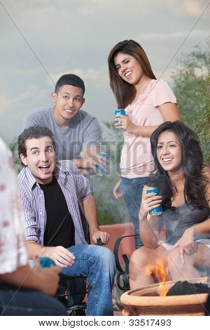 Teens Hanging Out At A Barbecue
