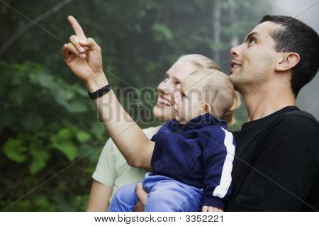 Mixed Hispanic Family With Cute Baby Boy In The Rain Forest