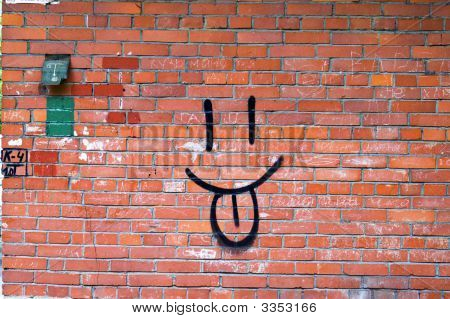 Smile Graffiti On Red Brick Wall