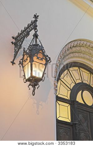 Old Lamp On A Cathedral'S Wall