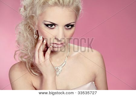 Sexy Beautiful Blond Woman Model With Wedding Decoration Over Pink