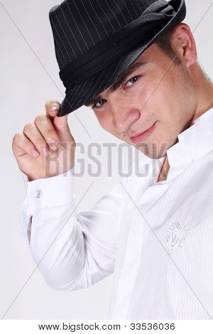 Portrait Of Sexy Fashion Man In Hat Posing On White Background