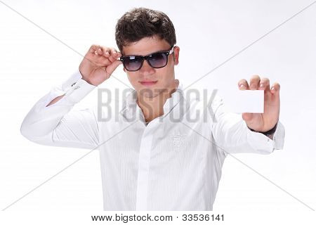 Stylish Cute Man Holding A Card In Hand Isolated Over Whit