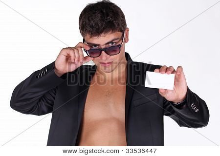 Portrait Of Handsome Young Man With Card In Glasses Posing On White Back