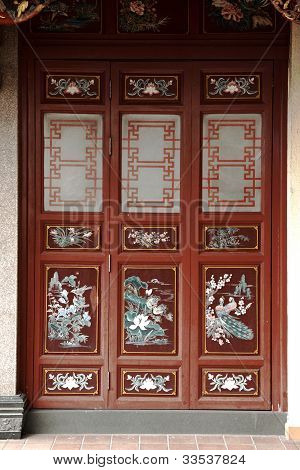 old Chinese Buddhist Taoist temple's wooden red door