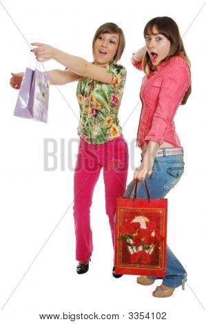 Two Funny Girls Carrying Bags