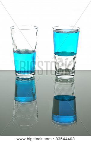 Two Glasses With Blue Liquid, Half Full, Half Empty