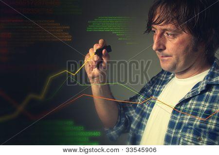 Casual Man Drawing A Rising Chart