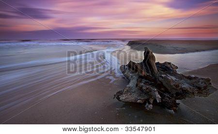 Sunset over sandy beach on the Atlantic shore