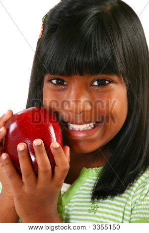 Beautiful Indian Girl With Apple