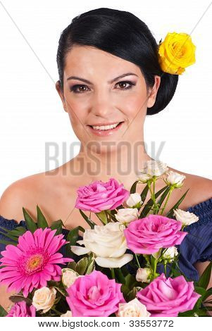 Beaty Woman Holding Colorful Flowers