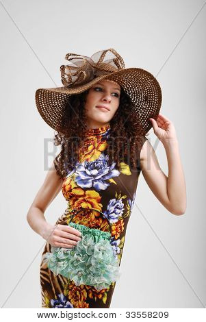 Pretty Girl With A Handbag And A Hat.