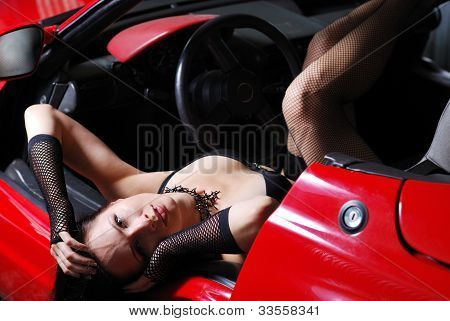 Half-dressed Woman Lying In The Car.