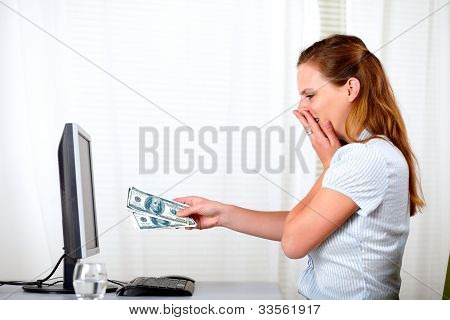 Surprised And Excited Girl With Cash Dollars