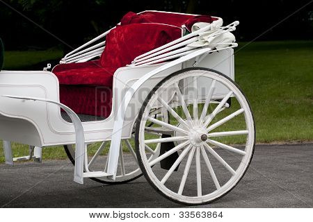 Classy White Carriage With Red Velvet Lined Bench
