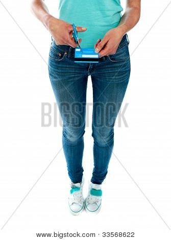 Woman Cutting Credit Card With Scissors