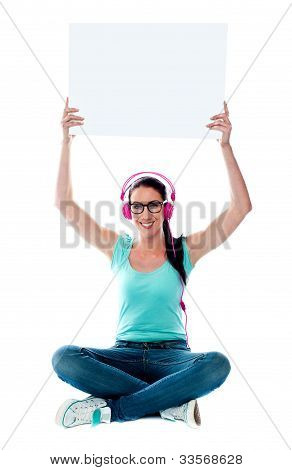 Casual Musical Woman Holding Blank Billboard
