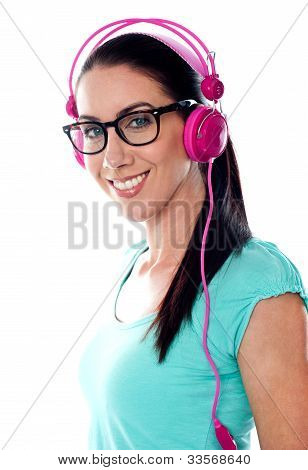 Pretty Girl Tuned Into Listening Music Via Headphones