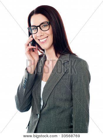Smiling Female Executive Talking On Mobile