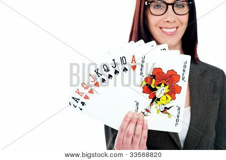 Charming Businesswoman Holding Playing Cards