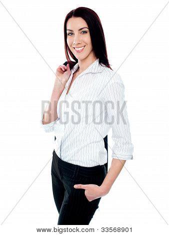 Stylish Female Executive Holding Coat Over Her Shoulders