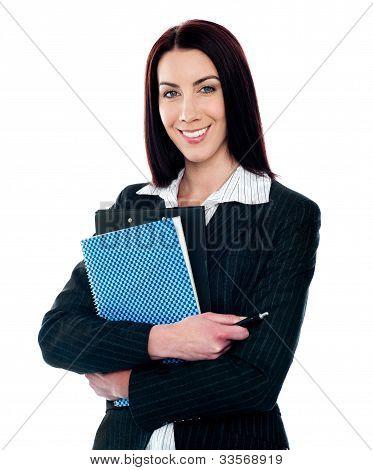 Portrait Of Smart Smiling Secretary Holding File