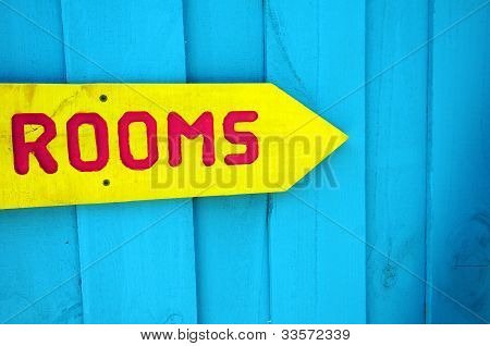 Yellow Sign To Rooms