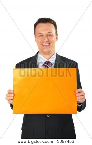 Businessman With Orange Leaf Of Paper.