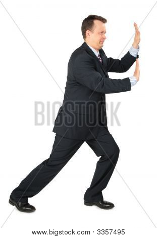 Businessman Rests Hands Against Wall Push Somthing