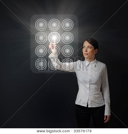 Woman Pushing Button On Dial Panel