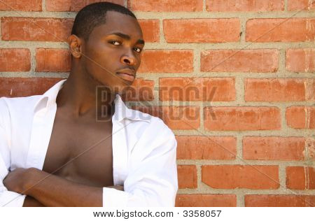 Handsome Male Model With Serious Look And Arms Folded