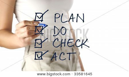 Woman Writing Plan, Do, Check, Act