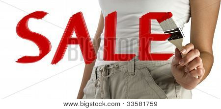 Woman Painting Red Sale Sign