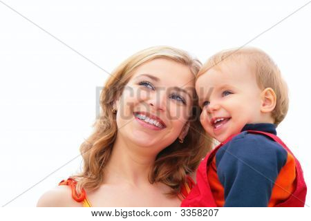Mother Holds Child On Hands
