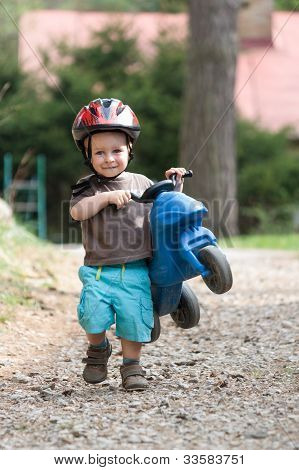 Young Boy With Helmet And Children's Bike