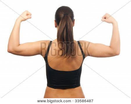 Strong and muscular young woman showing her muscles isolated on white
