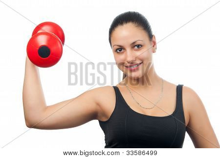 Beautiful girl exercising with dumbbell isolated on white